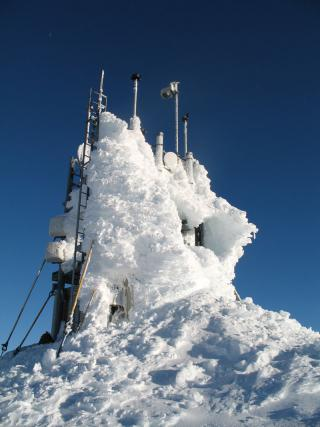 Sheep Mountain tower is one of the mountaintop sites that collects wind and temperature information that is used to decide whether turbulence is present in the area. As can be noted from the rime ice accumulation on the tower, operation and maintenance of the JAWS system is often challenging because of harsh environmental conditions. To better warn pilots of potentially dangerous turbulence, the FAA and Juneau airport officials turned to NCAR's Research Applications Laboratory (RAL) for a solution. RAL scientists had previously designed the software used in the turbulence alerting system developed for Hong Kong's International Airport, which has turbulence issues similar to Juneau's. The FAA asked RAL scientists to create a similar, prototype system for Juneau.