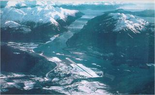"The above photo shows the Juneau International Airport and Gastineau Channel. The patches of churning water seen in multiple areas of the channel give an indication of the strength of the northerly wind conditions and turbulence that planes can expect to encounter when flying along the waterway. (Photo credit: John ""Jack"" Hermle)."