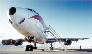 This DC–8 cargo aircraft encountered extreme clear–air turbulence over the Colorado Rocky Mountains on 9 Dec 1992, resulting in the loss of the right outboard engine and part of the right wing. (Photo courtesy of the Denver Post)