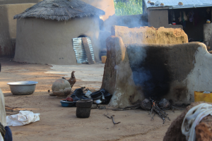 Traditional three-stone cooking in outdoor area of a home in the K-N District of Northern Ghana.
