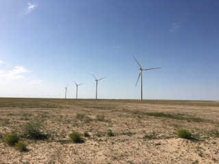 Figure 2. Four of the five wind turbines of the 10-MW wind plant at the Shagaya Renewable Energy Park in western Kuwait.