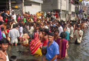 Citizens of Dhaka, Bangladesh standing in line for food stuffs during severe flooding in 2004. RAL scientists provided forecasts to the Bangladesh government to warn of this event with forecasts extending out 10 days before this event.