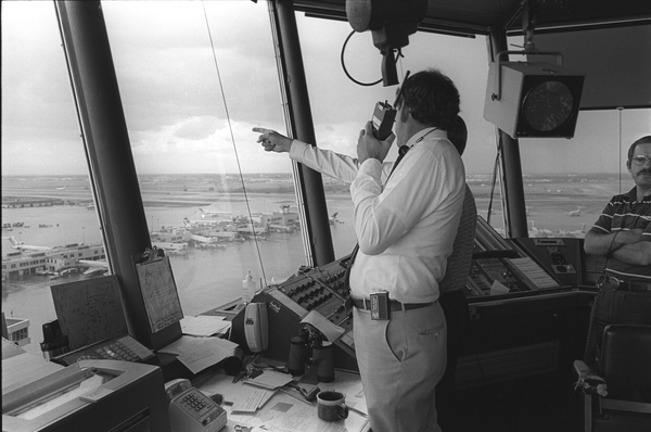 John McCarthy in control tower at Stapleton Airport, Denver, during CLAWS project, 1984