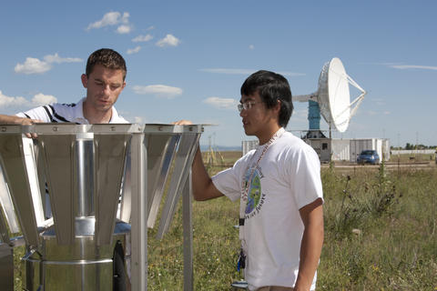 Scott Landolt, NCAR scientist, works with high school intern, Andy Sun, at the Marshall Field Site.