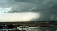 Descending air curls outward and upward as it slams into the ground in a microburst near Denver's former Stapleton International Airport on July 6, 1984, during the CLAWS project. (Photo by Wendy Schreiber-Abshire, ©UCAR. This image is freely available for media & nonprofit use.)